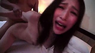 Beautiful Asian girl has two boys sharing her hairy snatch