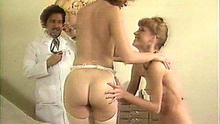 Big tits Nurse Amber Lynn in stockings enjoying pussy licking