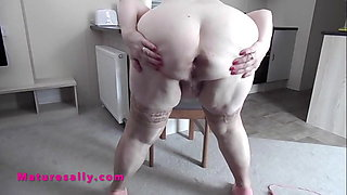 My Granny strips and shows her massive tits