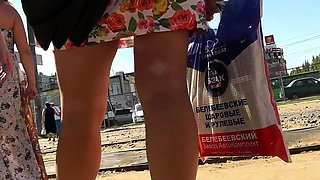 Attractive Russian teen with sexy long legs upskirt outside