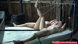 Restrained babe punished during BDSM