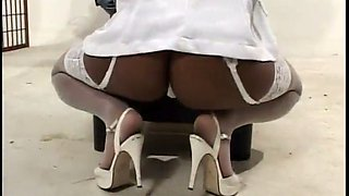 ebony nurse gives her patient an exam