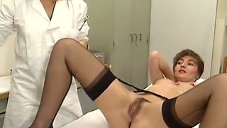 Nasty gynecologist goes lesbian with a client in retro sex scene