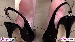 Catwoman takes off heels and teases you with her barefeet