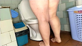 Chubby wife pissing on the toilet