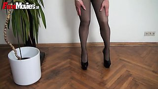 Slutty latex nun rubbing her kinky latex costume