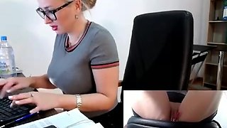 MILF playing with a remote vibrator at the office