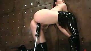 Sadomaso girl in lether stockings gets it deep from fuck machine