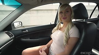 Blonde beauty Paisley blows cock in a car and gets fucked doggy style