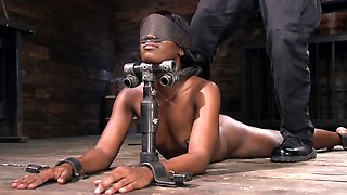 Ana Foxxx is blindfolded and spanked on a hard wood floor