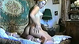 Blond haired amateur housewife with big rack was sitting on her hubby's face