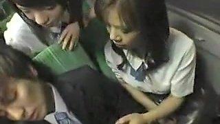 Two attractive Oriental schoolgirls seducing an older guy o