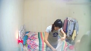 Several girls in a collective dormitory in China changed clothes