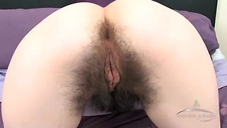 Marie Skyler In Very Hairy Laufy Strips And Masturbates On Purple Bed