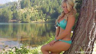 Bikini on a busty blonde stripping by the calm lake
