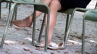 Sensuous amateur girl exposing her lovely feet outside