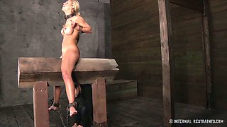 Horny blonde nympho with big fake tits gets punished like never before