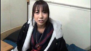 Alluring Oriental girl in uniform brings her fantasy to life
