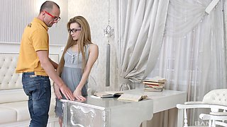 Russian blonde babe Sonia Sweet gets her glasses cum stained