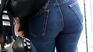 Sexy milf in tight jeans waiting for bus 1