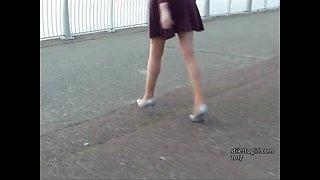 Leggy brunette teases long legs in high heel shoes fetish