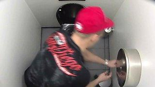 Three boys secretly filmed in a public toilet