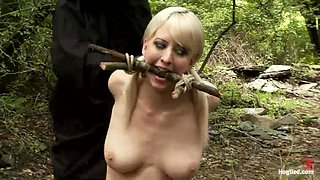 Submissive girls get humiliated in a forest by two men