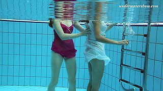 Attractive hotties Sima Lastova and her girlfriend strip under the water
