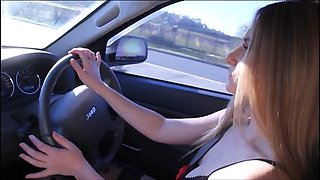 Driving car in very short dress and stockings