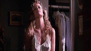 Kim Basinger in a white slip with hard nipples as she poses