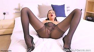 leggy brunette babe masturbates wet pussy in black pantyhose