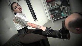Enticing amateur brunette in black boots punishes her slave
