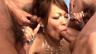 Guys warm Japanese girl's pussy properly before group sex begins