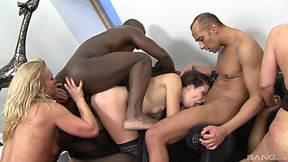 Deep pussy and ass fucking during an interracial group sex