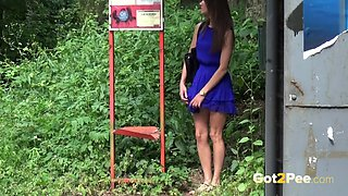 Pretty brunette is nearly caught pissing in a bus stop!