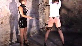 Mistress whips slavegirl