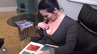 Buxom mature amateur brunette secretary Ilsa S. strips at an office