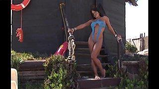 Amazing brunette in open sling bikini