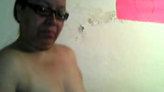 Mature and busty latina lady shows her booty and tits on webcam