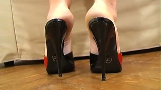 Lewd light haired MILF with big rack gets rid of heels to show soles