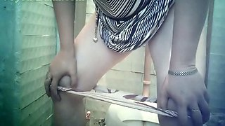 Pale skin stranger girl in the toilet wipes her pussy