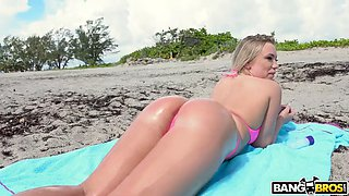 Blonde bailey brooke takes sunbathes on the beach