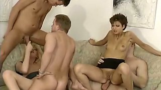 Gorgeous German classic bitches havingsmall orgy on the couch