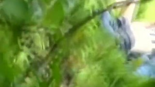 Voyeur hidden in the bushes catches teen couple fucking