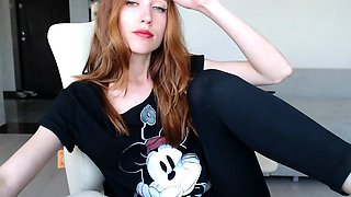 Sexy redhead camgirl exposes her slim body and tight peach