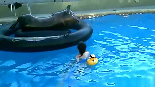 Nadia Plays With Pool Toys