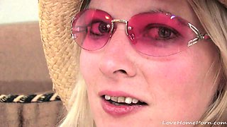 Horny chick with pink glasses touches herself