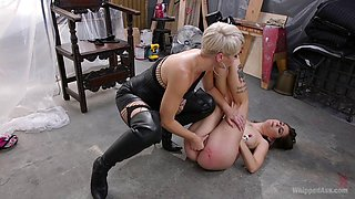 Slave bitch and her lesbian mistress have fun