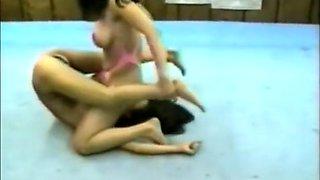 Asian women ring wrestling facesitting
