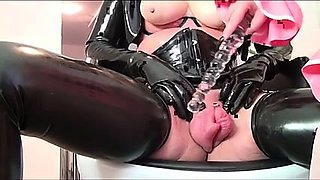 Kinky bitch in black latex toying her pumped up fuck hole